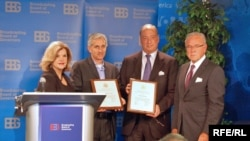 RFE/RL President Jeff Gedmin (second from left) accepts RFE/RL's David Burke Awards with BBG members.
