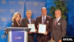 RFE/RL President Jeff Gedmin (second from left) accepts RFE/RL's David Burke Awards with BBG members.