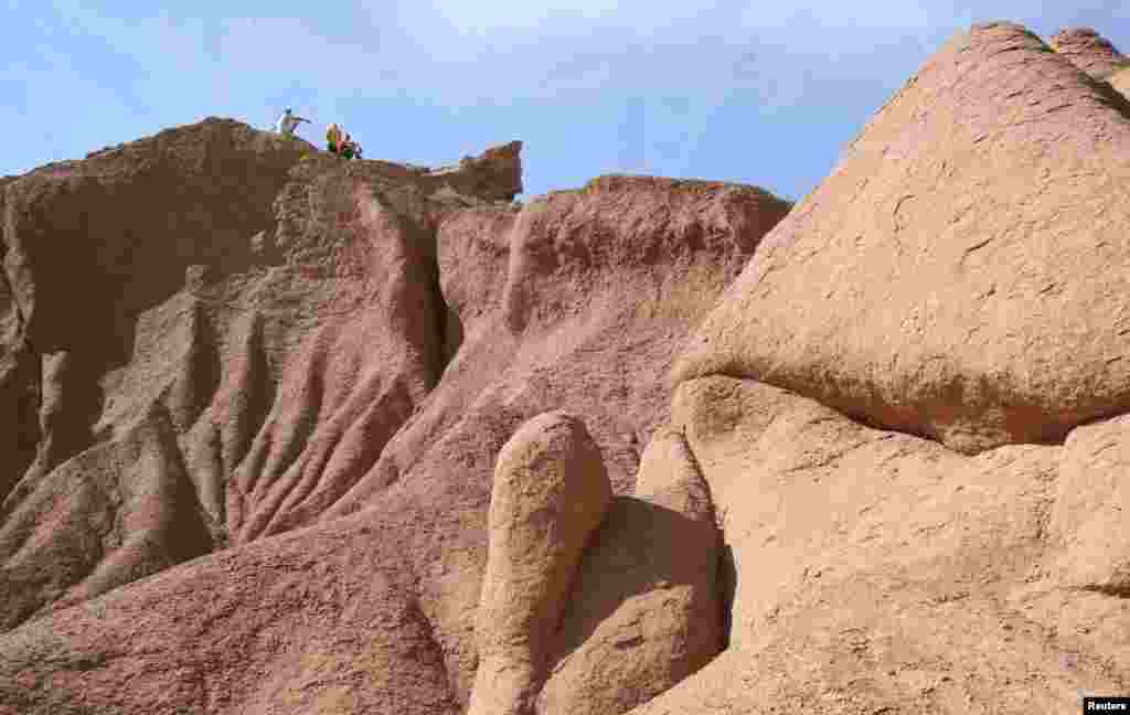 """The peculiar eroded land formations of the nearby """"Canyon of Wonders"""" are a popular trekking destination for tourists."""
