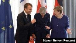 Эммануэль Макрон, Тереза Мэй и Ангела Меркель (слева вправо), архивное фото