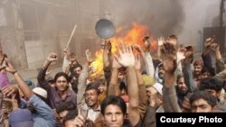 Members of the Christian community in Lahore protest on March 10 after a mob set fire to their homes.