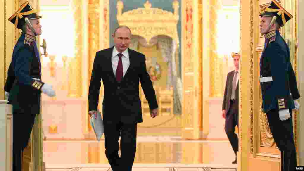 Russian President Vladimir Putin arrives to deliver the annual state-of-the-nation address at the Kremlin in Moscow. (ITAR-TASS/Mikhail Klimentyev)