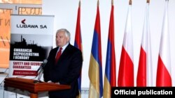 Armenia - A Polish defense industry official speaks at the inauguration of a Polish-Armenian joint venture in Charentsavan, 16Oct2014.