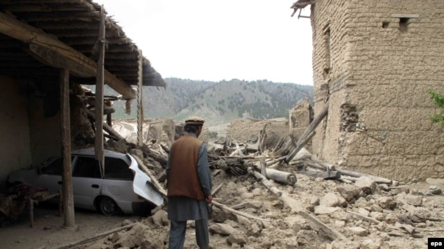 A local tribesman inspects a suspected militant hideout in North Waziristan after a recent air strike by a Pakistani war plane.