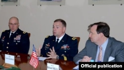 Armenia - U.S. Army Europe commander Ben Hodges (C) at a meeting with Armenian Defense Minister Seyran Ohanian in Yerevan, 23May2016.