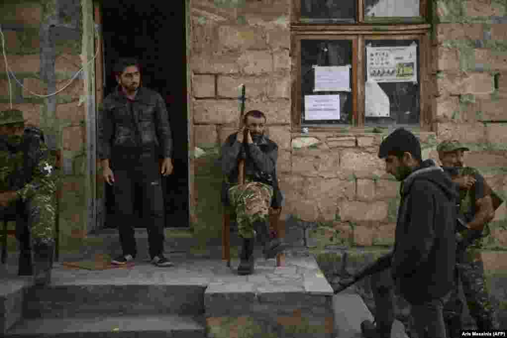 "Ethnic Armenian gunmen rest in a village south of Stepanakert.   In August 2020, just before the latest hostilities broke out, lawmaker Sasun Mikaelian called for a formal volunteer militia to be formed to supplement Armenia's military. Mikaelian said such a militia was necessary because Armenia was ""surrounded by enemies."""