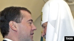 President Dmitry Medvedev and Patriarch Kirill speaking in January.