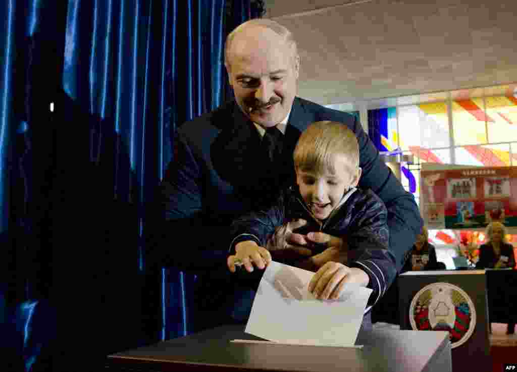 Lukashenka votes at a polling station in Minsk in September 2008, 4-year-old Kolya at his side.