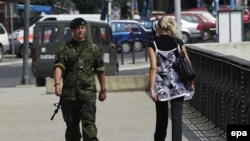 A NATO soldier patrols on a bridge in the ethnically divided town of Mitrovica, in northern Kosovo, in July.