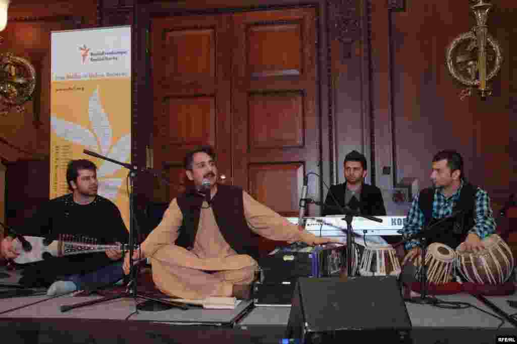 Radio Mashaal broadcaster Haroon Bacha (second from left) and accompanying musicians perform at the opening ceremony - (Photo by P. Alunans)