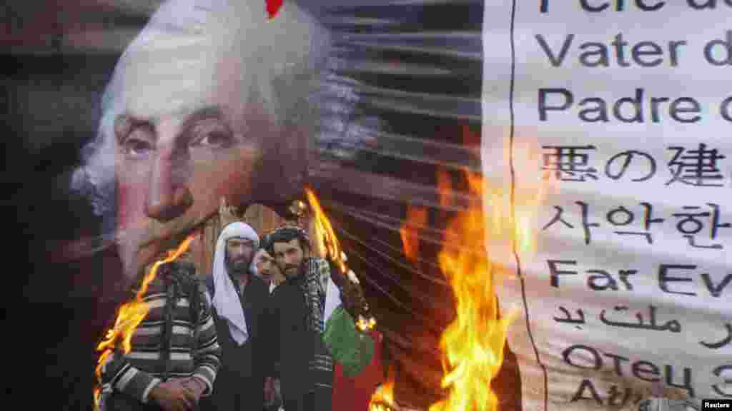 Pakistanis burn a poster of George Washington during a demonstration in Quetta following the massacre of 16 Afghans allegedly by a U.S. soldier. (Reuters/Naseer Ahmed)