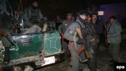 Оқиға орнына келген Ауғанстан полициясы. Кабул, 17 қаңтар 2014 жыл.