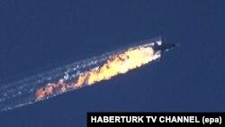 Ресейдің атып түсірілген Су-24 ұшағы туралы видеодан скриншот. 24 қараша 2015 жыл.