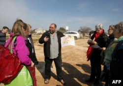 Yehuda Shaul (center), from the Israeli NGO Breaking the Silence, talks to members of the European Parliament during a visit to the Palestinian village of Susya in the West Bank in February.