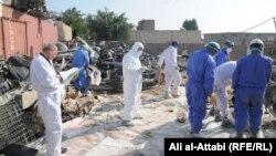 فرق متخصصة تزيل مواد ملوثة إشعاعياً في الناصرية