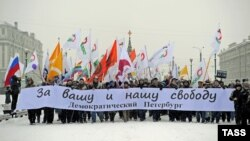 "Opposition demonstrators stage a march ""For your and our freedom"" in central St. Petersburg on December 9."