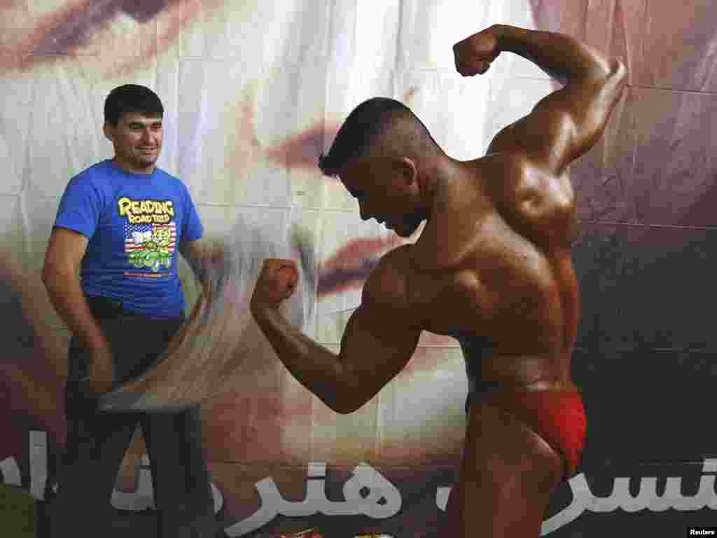 A man prepares for a bodybuilding competition in Kabul. Photo by Omar Sobhani for Reuters.