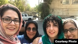 FILE - Narges Mohammadi (C), Iranian human rights activist.