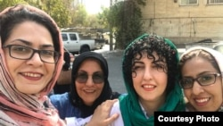 Narges Mohammadi (2nd from R), Iranian human rights activist, on a brief leave from prison greeted by other female activists. Sep 2018. FILE PHOTO