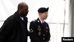 U.S. Army Private First Class Bradley Manning (right) arriving at the courthouse for a motion hearing at Fort Meade in Maryland in late May.