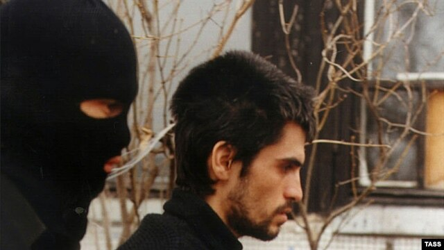 An alleged IMU member is handed over to Uzbek intelligence services by Russia (file photo).