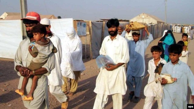 Pakistani refugees prepare to go back to the Swat region.