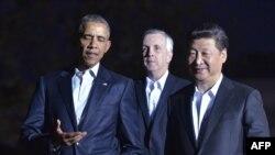 Барак Обама ва Си Цзиньпин.