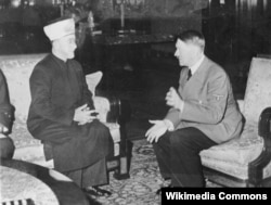 Мухаммад Амин аль-Хусейни на приеме у Гитлера. Берлин, 28 ноября 1941 года. Фото Генриха Гофмана. © Bundesarchiv, Bild 146-1987-004-09A / Heinrich Hoffmann / CC-BY-SA 3.0