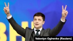 Zelenskiy appeals to the crowd at the debate.