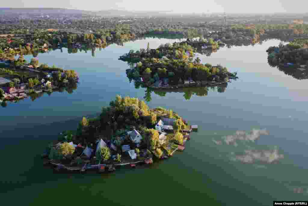 Holiday homes are clustered together on an islet on Kavicsos-to, a lake south of Budapest.