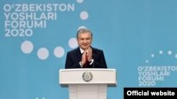 Uzbek President Shavkat Mirziyoyev attends the Youth Forum of Uzbekistan in Tashkent on December 25.