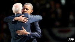 Reelected U.S. President Barack Obama and Vice President Joe Biden embrace after his victory speech on election night at McCormick Place in Chicago.