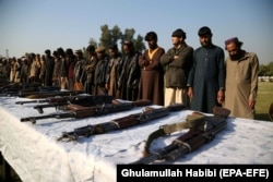 Former militants surrender their weapons during a reconciliation ceremony in Jalalabad in December 2019.