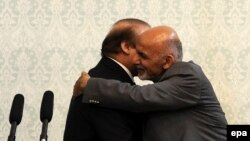 Pakistani Prime Minister Nawaz Sharif (left) and Afghan President Ashraf Ghani hug during Sharif's visit to Kabul on May 12.