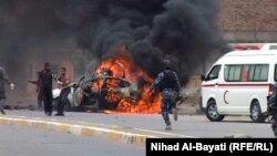 سيارة تحترق بعد تفجير في كركوك