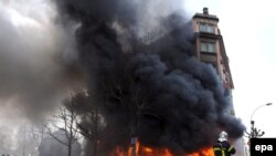 Firefighters battle flames at the Strasbourg hotel set alight during the NATO summit on April 4.