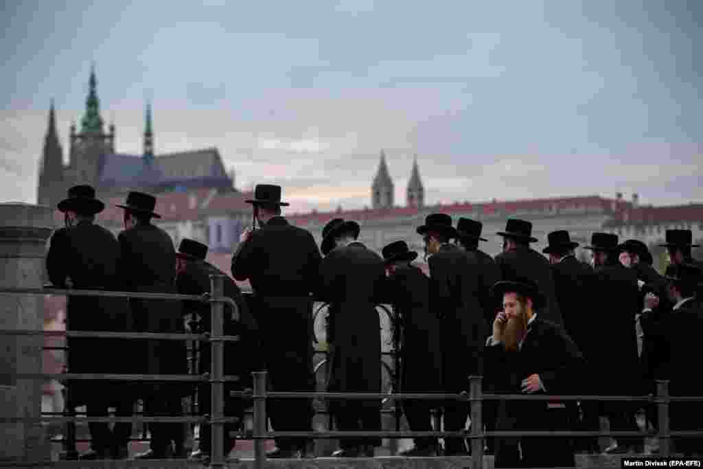 Orthodox Jews stand on the bank of the Vltava River as they tour around the Czech capital, Prague. (epa-EFE/Martin Divisek)