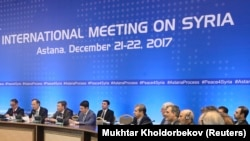 Members of the delegations take part in the peace talks on Syria in Astana, Kazakhstan December 22, 2017.