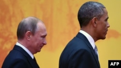 Relations between Russian President Vladimir Putin (left) and U.S. President Barack Obama have gone ice-cold since Washington and its allies accused Russia of conducting a covert war on Ukraine, beginning with its occupation and unrecognized annexation of Crimea a year ago.