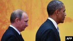 Президент США Барак Обама (cправа) и президент России Владимир Путин. Пекин, 11 ноября 2014 года.