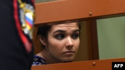 Aleksandra Ivanova (aka Varvara Karaulova) sits inside a defendants' cage during a hearing at a Moscow court last month.