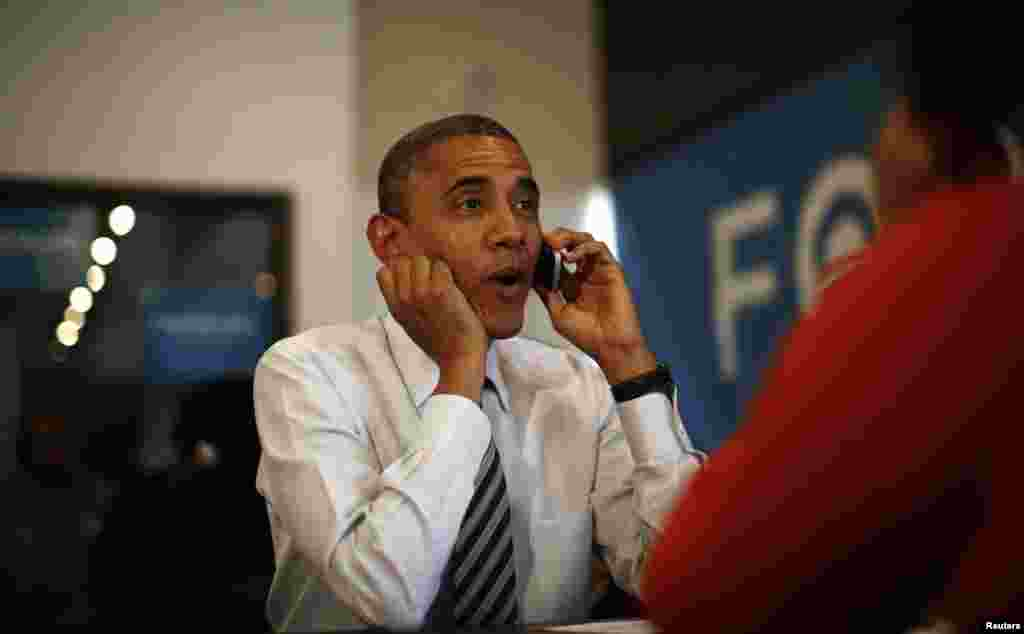 U.S. President Barack Obama makes a phone call to a campaign volunteer during a visit to a field office in Chicago on Election Day.