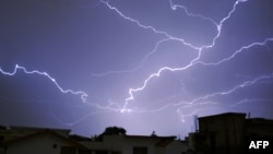 Pakistan - Lightning breaks during a thunderstorm in the Pakistani capital Islamabad on June 1, 2016.