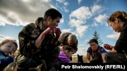 Russia -- file -- August 15, 2016 -- Yadne family members gather around slaughtered rendeer to enjoy fresh meet and blood in the family herding camp on the left bank of Yenisey river in West Siberia