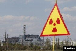 A general view shows of the sarcophagus covering the damaged fourth reactor at the Chernobyl nuclear power plant in May 2015
