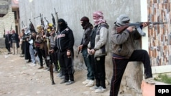 Вооруженные бойцы суннитского ополчения в Фаллудже, 5 января 2014 года.