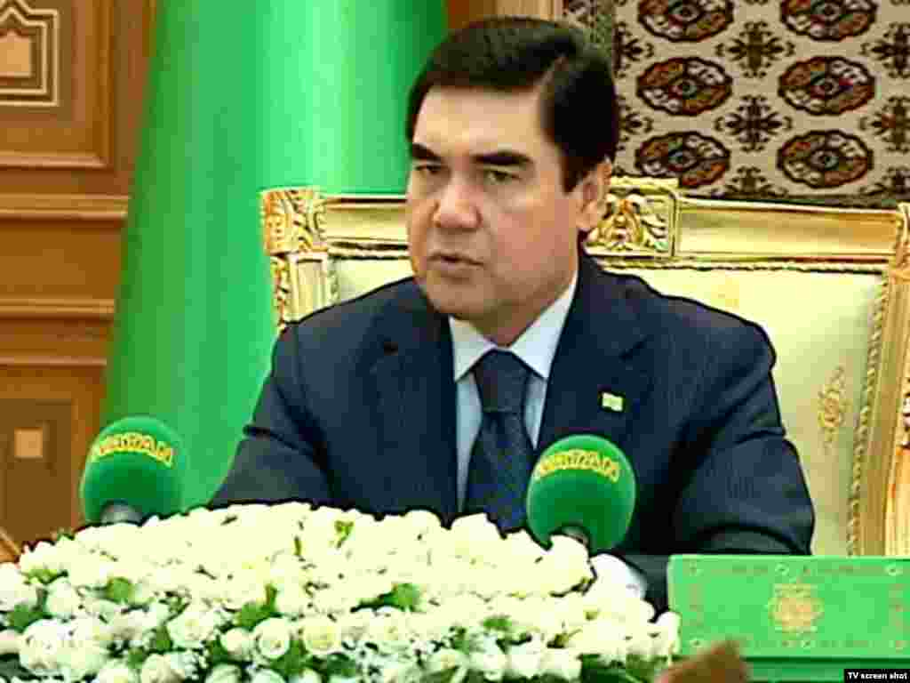 "Berdymukhammedov at a cabinet meeting. The Turkmen president is frequently shown against a foreground of white roses, and is even the subject of an adulatory poem entitled ""White Roses."""