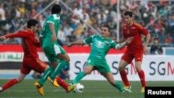 مباراة ودية بكرة القدم بين المنتخبين العراقي والسوري على ملعب الشعب الدولي ببغداد في 26/3/2013.