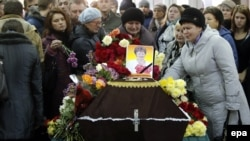 Mourners grieve at the coffin of Nina Lushchenko, a victim of the Russian MetroJet Airbus A321 crash in Egypt, during her funeral service at a church in Veliky Novgorod on November 5.