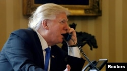 U.S. President Donald Trump speaks to Russian President Vladimir Putin by telephone from the White House in January.